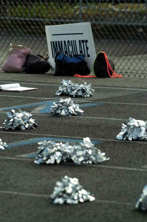 Off-field action at the Immaculate vs. Pomperaug football game at Immaculate High School on Saturday, Oct. 1, 2011. Photo: Jason Rearick / The News-Times