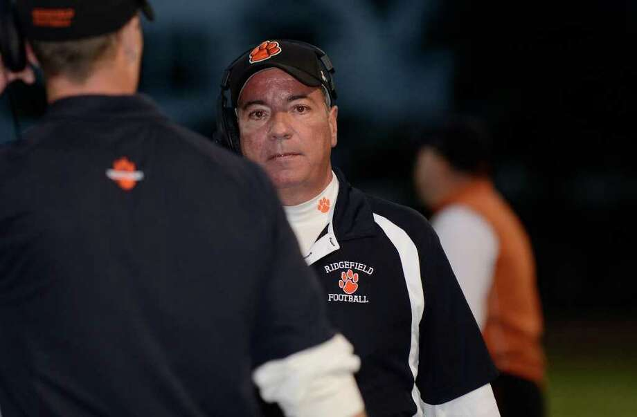 Ridgefield varsity coach Kevin Callahan walks the sidelines as Stamford High School hosts Ridgefield High School in varsity football action in Stamford, CT on Saturday, Oct. 1, 2011. Photo: Shelley Cryan / Shelley Cryan freelance; Stamford Advocate freelance