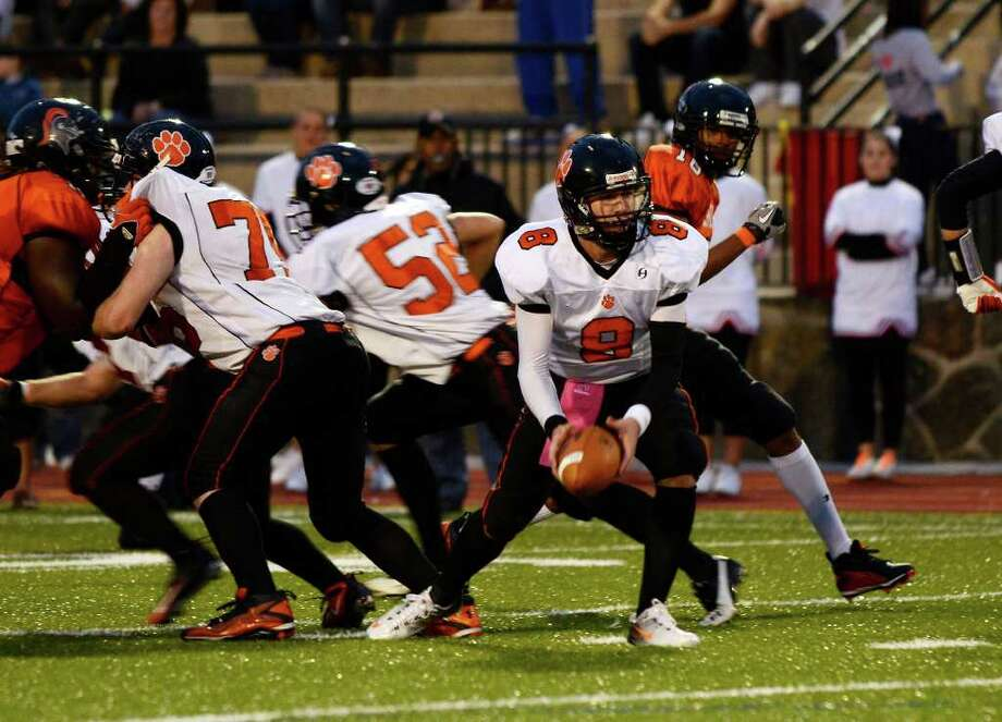 Ridgefield's #8 Connor Rowe gets ready for a hand-off as Stamford High School hosts Ridgefield High School in varsity football action in Stamford, CT on Saturday, Oct. 1, 2011. Photo: Shelley Cryan / Shelley Cryan freelance; Stamford Advocate freelance