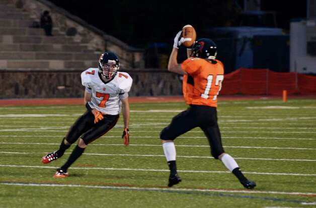 Stamford's Nick Palumbo picks up an tipped-ball interception as Stamford High School hosts Ridgefield High School in varsity football action in Stamford, CT on Saturday, Oct. 1, 2011. Photo: Shelley Cryan / Shelley Cryan freelance; Stamford Advocate freelance