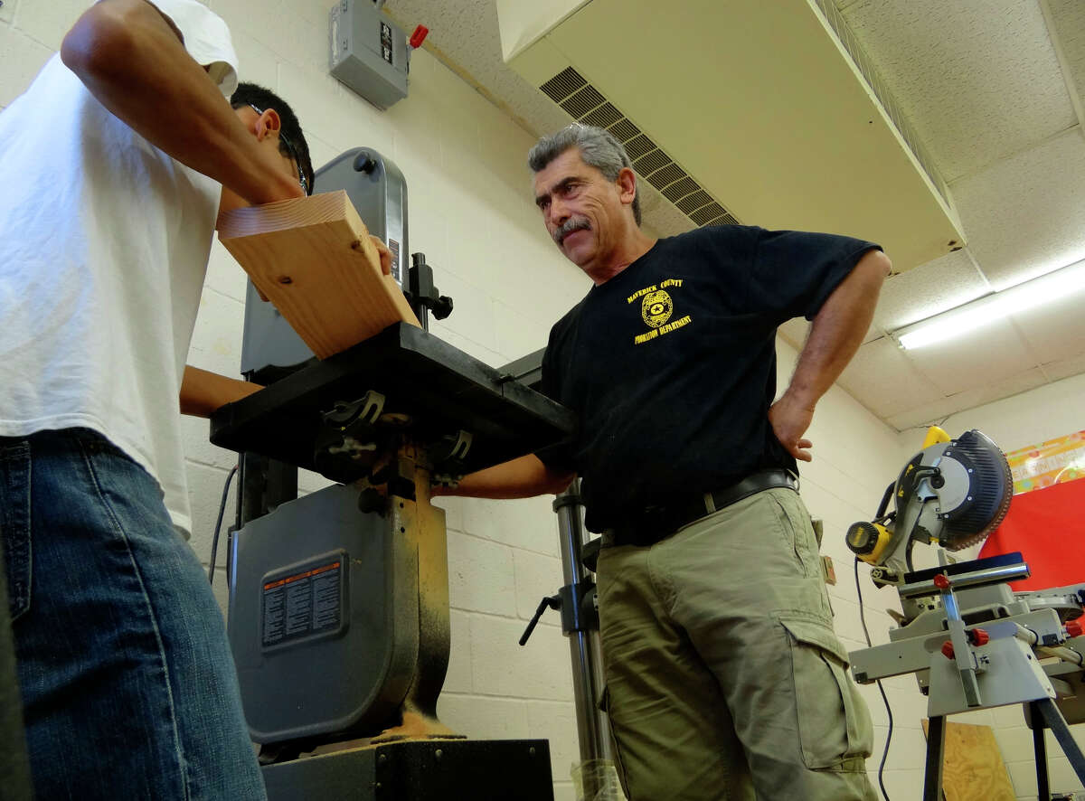 Bruce Ballou, chief probation officer of the juvenile probation department in Eagle Pass, and his fellow probation officers teach woodworking to youth that have been in trouble with the law on Thursday, Sept. 22, 2011.