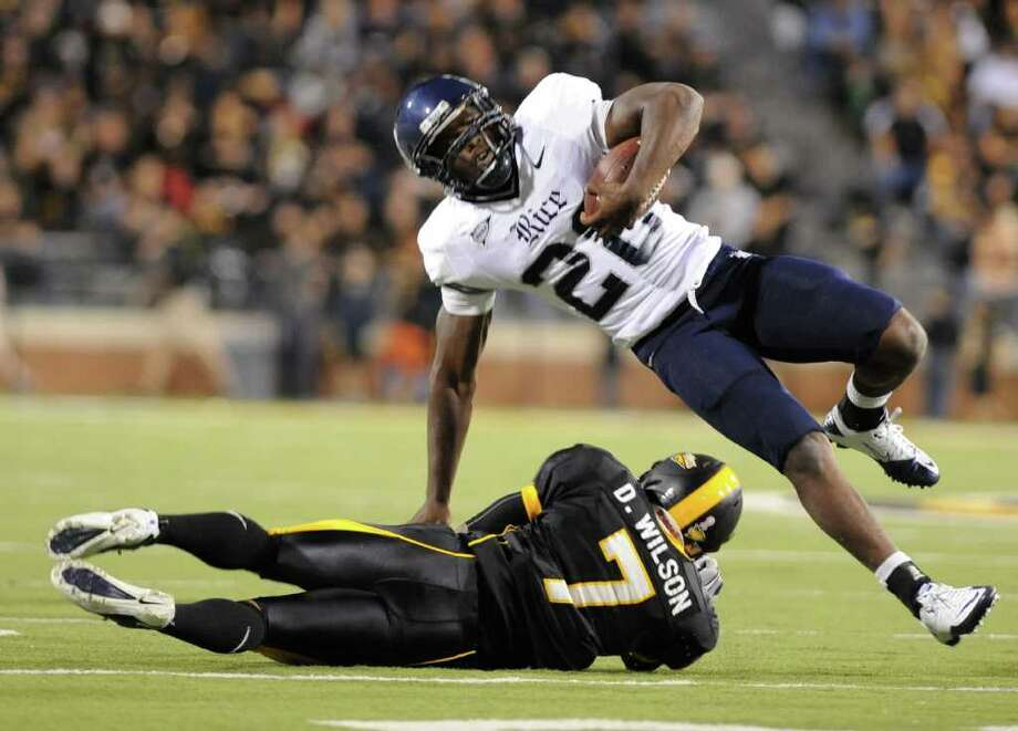 Southern Mississippi's Deron Wilson tackles Rice running back Charles Ross during an NCAA college football game in Hattiesburg Miss., Saturday, Oct. 1, 2011.(AP Photo/ Hatiesburg American, Ryan Moore) NO SALES Photo: Ryan Moore, Associated Press / Ryan Moore- Hattiesburg American