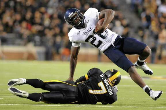 Southern Mississippi's Deron Wilson tackles Rice running back Charles Ross during an NCAA college football game in Hattiesburg Miss., Saturday, Oct. 1, 2011.(AP Photo/ Hatiesburg American, Ryan Moore) NO SALES