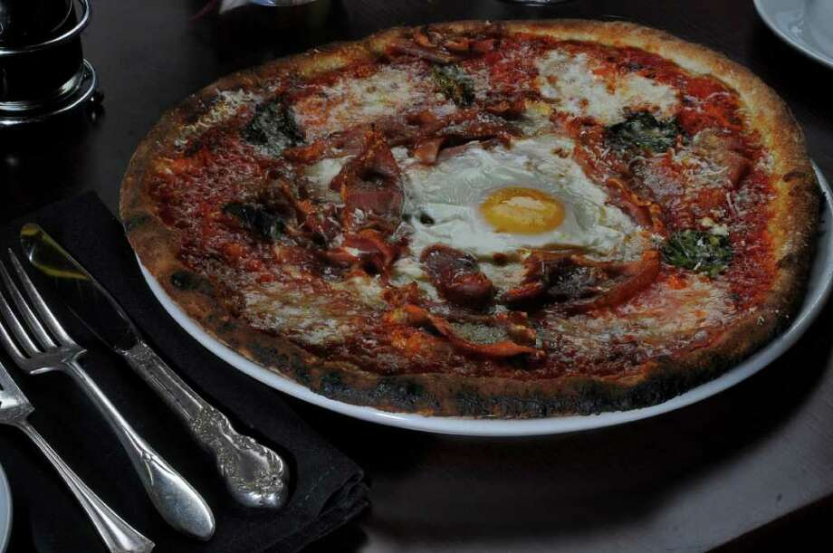 Prosciutto and egg pizza at Capriccio Saratoga on Monday Sept. 26, 2011 in Saratoga Springs, NY.  ( Philip Kamrass / Times Union) Photo: Philip Kamrass / 00014757A