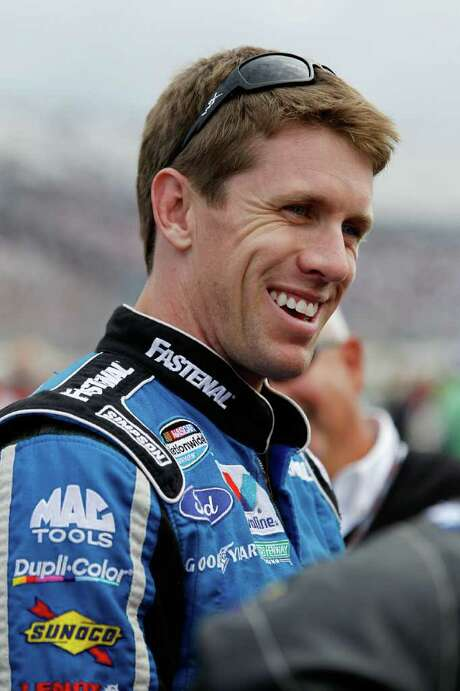DOVER, DE - OCTOBER 01:  Carl Edwards, driver of the #60 Fastenal Ford, smiles on the grid during the NASCAR Nationwide Series OneMain Financial 200 at Dover International Speedway on October 1, 2011 in Dover, Delaware.  (Photo by Sean Gardner/Getty Images for NASCAR) Photo: Sean Gardner / 2011 Getty Images