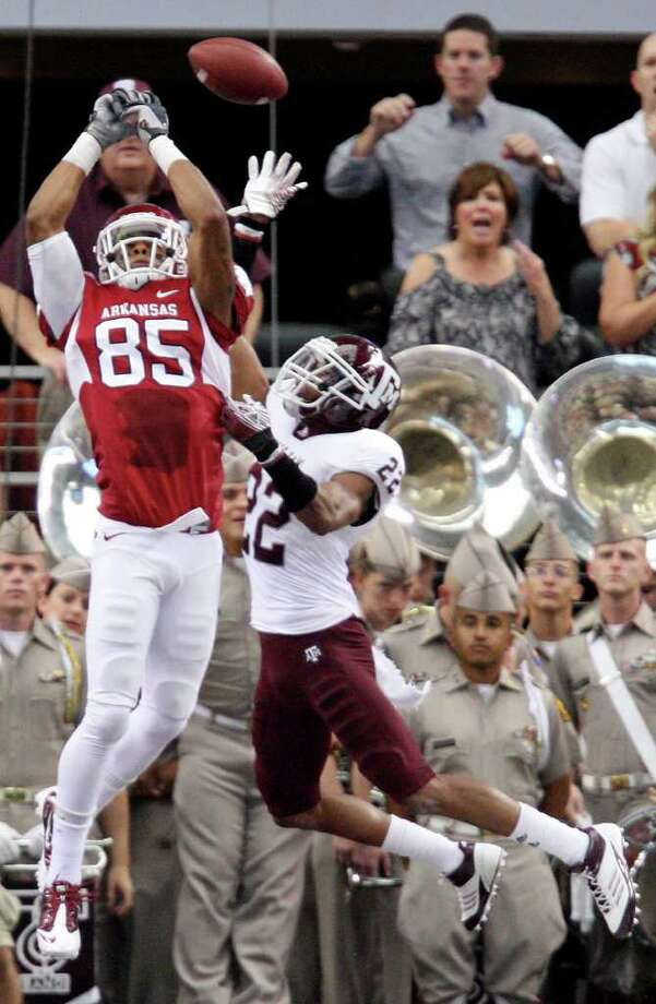 FOR SPORTS - Arkansas' Greg Childs misses a pass as he is defended by Texas A&M's Dustin Harris during first half action of the 2011 Southwest Classic Saturday Oct. 1, 2011 at Cowboys Stadium in Arlington, TX. (PHOTO BY EDWARD A. ORNELAS/eaornelas@express-news.net) Photo: EDWARD A. ORNELAS, SAN ANTONIO EXPRESS-NEWS / © SAN ANTONIO EXPRESS-NEWS (NFS)