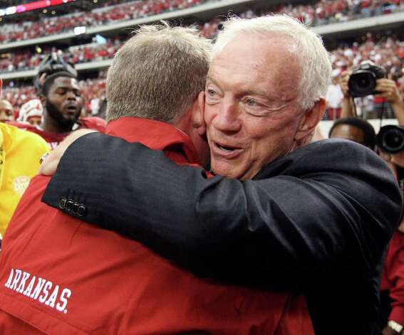 FOR SPORTS -  Dallas Cowboys owner Jerry Jones hugs Arkansas head coach Bobby Petrino after the 2011 Southwest Classic against Texas A&M Saturday Oct. 1, 2011 at Cowboys Stadium in Arlington, TX. Arkansas won 42-38. (PHOTO BY EDWARD A. ORNELAS/eaornelas@express-news.net) Photo: EDWARD A. ORNELAS, SAN ANTONIO EXPRESS-NEWS / © SAN ANTONIO EXPRESS-NEWS (NFS)