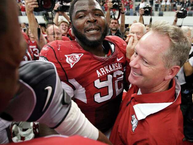 FOR SPORTS - Arkansas' DeQuinta Jones (left) celebrates with Arkansas' head coach Bobby Petrino after the 2011 Southwest Classic against Texas A&M Saturday Oct. 1, 2011 at Cowboys Stadium in Arlington, TX. Arkansas won 42-38. (PHOTO BY EDWARD A. ORNELAS/eaornelas@express-news.net) Photo: EDWARD A. ORNELAS, SAN ANTONIO EXPRESS-NEWS / © SAN ANTONIO EXPRESS-NEWS (NFS)