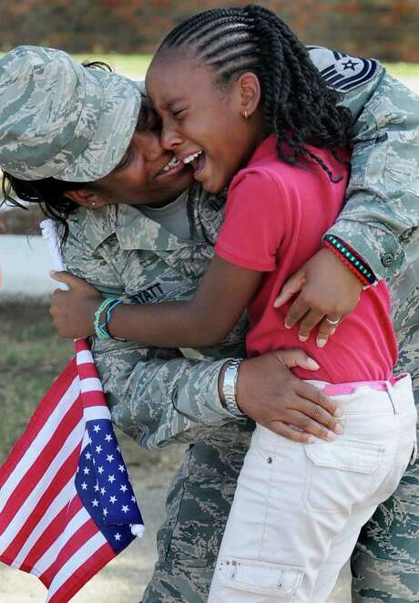 MICKEY WELSH : MONTGOMERY ADVERTISER HOME!: National Guard Master Sgt. Catina Hyatt surprises her daughter, Erykah Hyatt, on her ninth birthday. Photo: MICKEY WELSH / MONTGOMERY ADVERTISER
