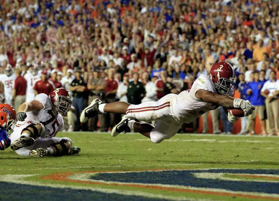 GAINESVILLE, FL - OCTOBER 01:  Trent Richardson #3 of the Alabama Crimson Tide dives for a touchdown during a game against the Florida Gators  at Ben Hill Griffin Stadium on October 1, 2011 in Gainesville, Florida.  (Photo by Sam Greenwood/Getty Images) *** BESTPIX *** Photo: Sam Greenwood / 2011 Getty Images