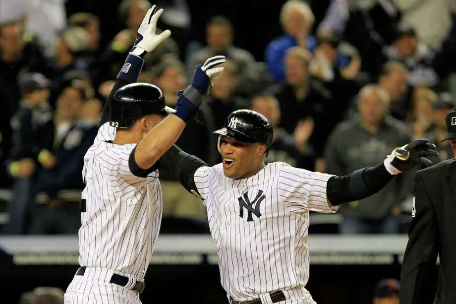 CHRIS TROTMAN: GETTY IMAGES GRAND WELCOME: The Yankees' Robinson Cano, right, is greeted by teammate Derek Jeter at home plate after Cano hit a grand slam in the sixth inning Saturday night. Photo: Chris Trotman / 2011 Getty Images