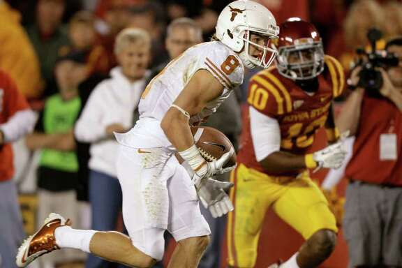 Texas wide receiver Jaxon Shipley (8) runs from Iowa State defensive back Jacques Washington, right, during a first-half touchdown reception in an NCAA college football game, Saturday, Oct. 1, 2011, in Ames, Iowa. (AP Photo/Charlie Neibergall)