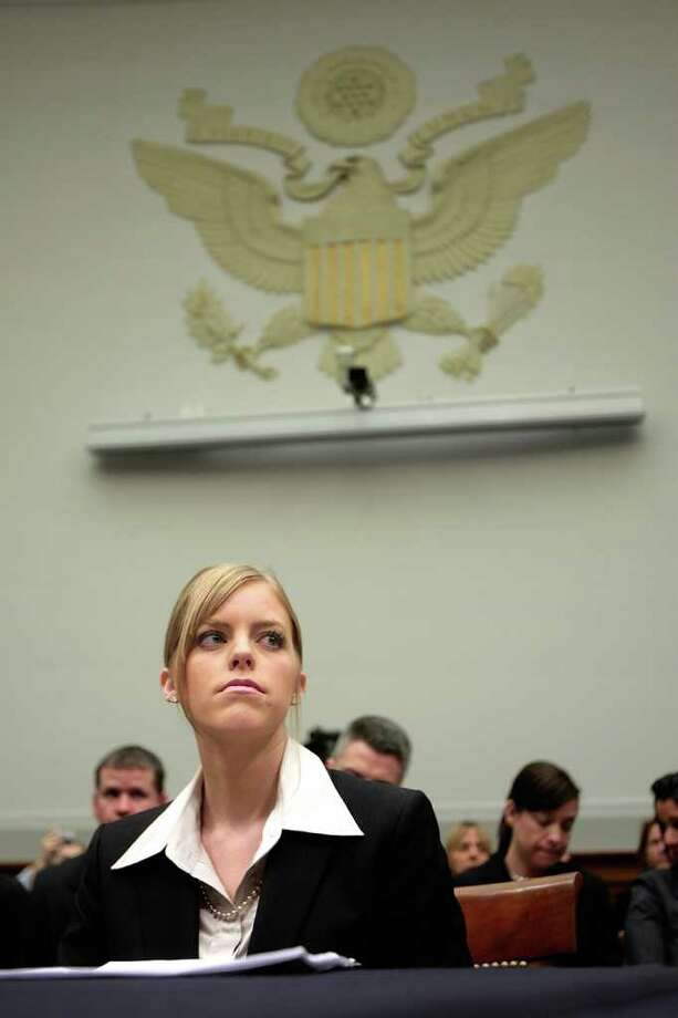 WASHINGTON - DECEMBER 19:  Jamie Leigh Jones prepares to testify before the House Subcommittee on Crime, Terrorism, and Homeland Security on Capitol Hill December 19, 2007 in Washington, DC. Jones says says that two years ago she was raped by co-workers and held against her will while working for KBR Inc., a large US contractor, at Camp Hope in Baghdad.   (Photo by Chip Somodevilla/Getty Images) Photo: Chip Somodevilla / Getty Images North America