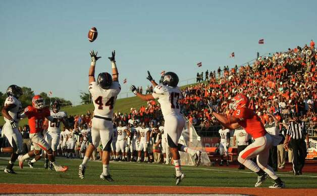 UTSA's Steven Kurfehs (44) intercepts a pass intended for Sam Houston's Grant Merrritt (3) during the first half of a college football game, Saturday, October 1, 2011 at Bowers Stadium in Huntsville, TX. Photo: Eric Christian Smith, For The San Antonio Express-News