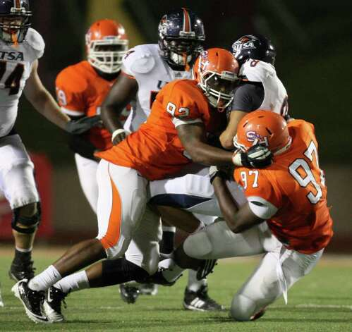 UTSA's Eric Soza (8) is sacked by Sam Houston's Andrew Weaver (92) and Jarrett Brown during the second half of a college football game, Saturday, October 1, 2011 at Bowers Stadium in Huntsville, TX. Photo: Eric Christian Smith, For The San Antonio Express-News