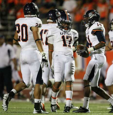 UTSA's Triston Wade (14) celebrates his fumble recovery with teammate Erik Brown (17) during the second half of their game against Sam Houston, Saturday, October 1, 2011 at Bowers Stadium in Huntsville, TX. Photo: Eric Christian Smith, For The San Antonio Express-News