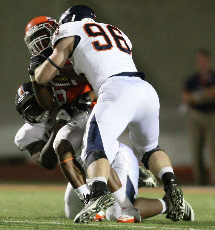 Sam Houston's Richard Sincere (6) is sacked by UTSA's Richard Burge (left) and Jason Neill during the second half of a college football game, Saturday, October 1, 2011 at Bowers Stadium in Huntsville, TX. Photo: Eric Christian Smith, For The San Antonio Express-News