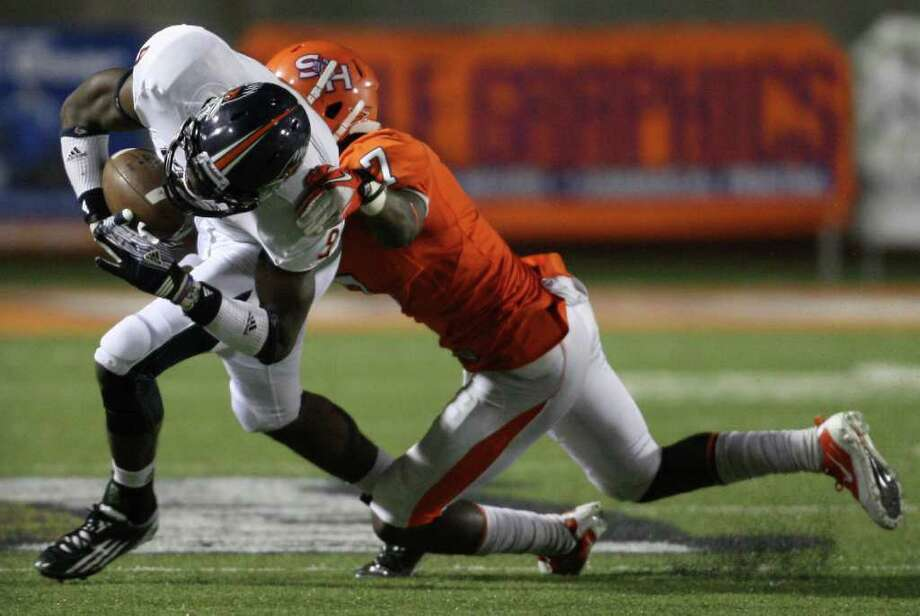UTSA's Marcellus Mack (left) tries to shake off the tackle of Sam Houston's Daxton Swanson during the second half of a college football game, Saturday, October 1, 2011 at Bowers Stadium in Huntsville, TX. Photo: Eric Christian Smith, For The San Antonio Express-News