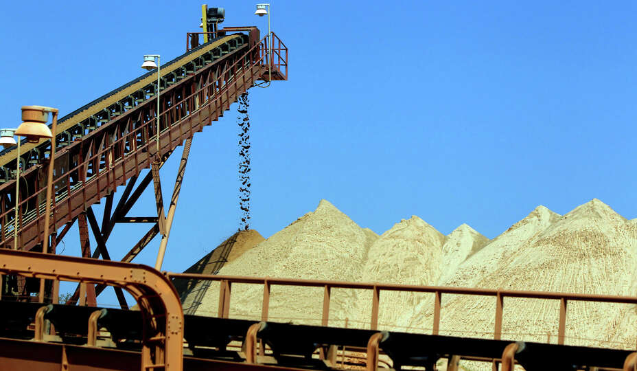 Sand and mined near Brady, Texas at the Frac Tech Services mining operation travels up a conveyor
