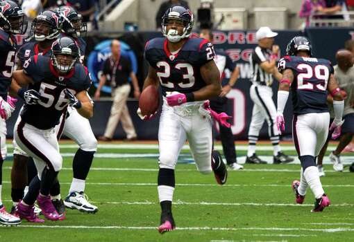 Houston Texans running back Arian Foster (23) runs the ball during pre-game warm ups before an NFL football game against the Pittsburgh Steelers at Reliant Stadium on Sunday, Oct. 2, 2011, in Houston. Photo: Brett Coomer, Houston Chronicle / © 2011  Houston Chronicle