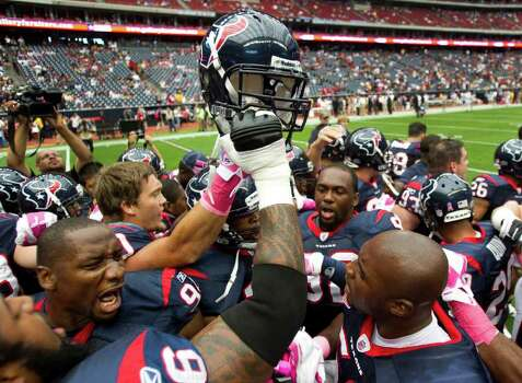 Houston Texans defensive end Antonio Smith, left, and Houston Texans inside linebacker DeMeco Ryans, lower right, lead the team in a pre-game huddle before an NFL football game against the Pittsburgh Steelers at Reliant Stadium on Sunday, Oct. 2, 2011, in Houston. Photo: Brett Coomer, Houston Chronicle / © 2011  Houston Chronicle