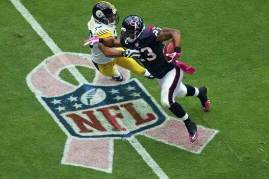 Houston Texans running back Arian Foster (23) runs past Pittsburgh Steelers linebacker Larry Foote (50) during the first quarter of an NFL football game at Reliant Stadium on Sunday, Oct. 2, 2011, in Houston. Photo: Smiley N. Pool, Houston Chronicle / © 2011  Houston Chronicle