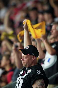 """A Pittsburgh Steelers fan waves a """"Terrible Towel"""" during the first quarter of an NFL football game against the Houston Texans at Reliant Stadium on Sunday, Oct. 2, 2011, in Houston. Photo: Smiley N. Pool, Houston Chronicle / © 2011  Houston Chronicle"""