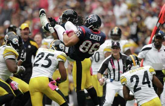 Houston Texans tight end James Casey (86) is upended by Pittsburgh Steelers strong safety Troy Polamalu (43) during the second quarter of an NFL football game at Reliant Stadium on Sunday, Oct. 2, 2011, in Houston. Photo: Brett Coomer, Houston Chronicle / © 2011  Houston Chronicle
