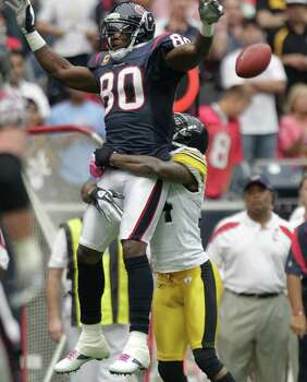Houston Texans wide receiver Andre Johnson (80) can't hold onto a pass as Pittsburgh Steelers cornerback Ike Taylor (24) defends during the first quarter of an NFL football game at Reliant Stadium on Sunday, Oct. 2, 2011, in Houston. Photo: Brett Coomer, Houston Chronicle / © 2011  Houston Chronicle