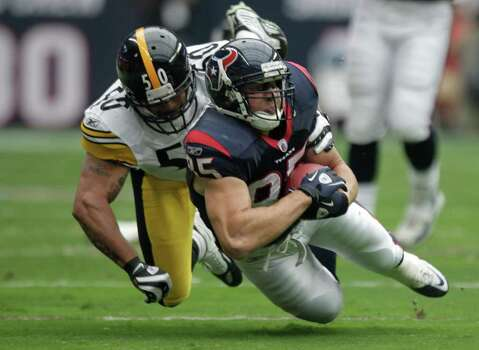 Houston Texans tight end Joel Dreessen (85) is brought down by Pittsburgh Steelers linebacker Larry Foote (50) during the first quarter of an NFL football game at Reliant Stadium on Sunday, Oct. 2, 2011, in Houston. Photo: Brett Coomer, Houston Chronicle / © 2011  Houston Chronicle