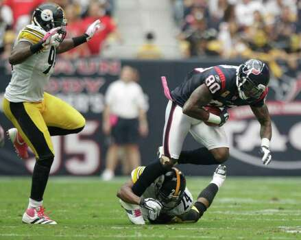 Houston Texans wide receiver Andre Johnson (80) is tackled by Pittsburgh Steelers cornerback Ike Taylor (24) during the second quarter of an NFL football game at Reliant Stadium on Sunday, Oct. 2, 2011, in Houston. Photo: Brett Coomer, Houston Chronicle / © 2011  Houston Chronicle