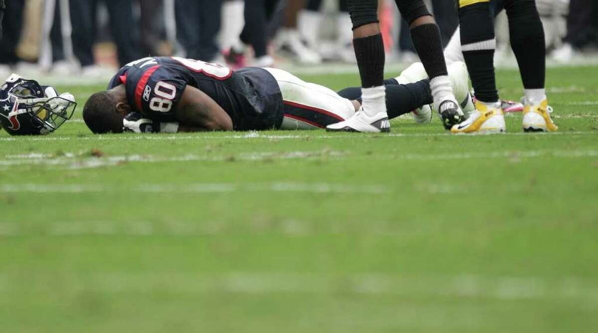 Houston Texans wide receiver Andre Johnson (80) is shaken up on a a play against the Pittsburgh Steelers during the second quarter of an NFL football game at Reliant Stadium on Sunday, Oct. 2, 2011, in Houston. Johnson left the field after the play.