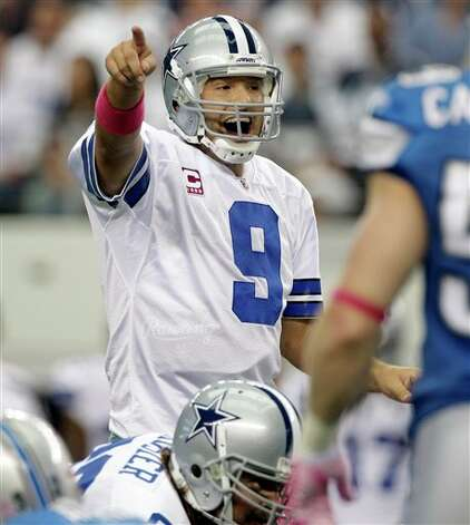 Dallas Cowboys quarterback Tony Romo makes a call from the line of scrimmage during the first quarter against the Detroit Lions at an NFL football game between the Detroit Lions and Dallas Cowboys Sunday, Oct. 2, 2011, in Arlington, Texas. (AP Photo/Tony Gutierrez) Photo: Tony Gutierrez, Associated Press / AP