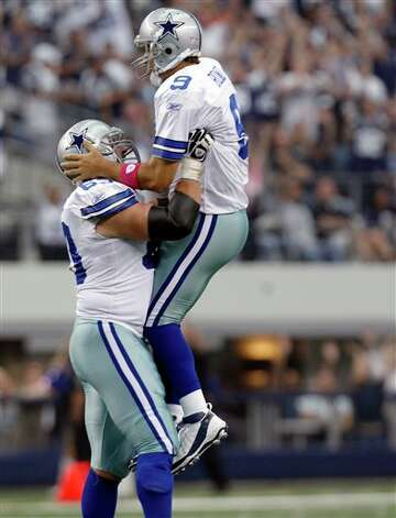 Dallas Cowboys guard Kyle Kosier celebrates a first-quarter, 25-yard touchdown pass byTony Romo, right, against the Detroit Lions in an NFL football game Sunday, Oct. 2, 2011, in Arlington, Texas. (AP Photo/LM Otero) Photo: LM Otero, Associated Press / AP