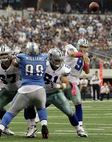 Dallas Cowboys quarterback Tony Romo throws a 6-yard touchdown pass to Dez Bryant during the second quarter against the Detroit Lions in an NFL football game Sunday, Oct. 2, 2011, in Arlington, Texas. (AP Photo/Tony Gutierrez) Photo: Tony Gutierrez, Associated Press / AP
