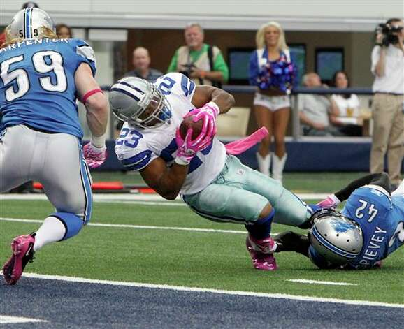 Dallas Cowboys running back Tashard Choice is stopped short of the goal line by Detroit Lions strong safety Amari Spievey as Bobby Carpenter, left, moves in during the first half of an NFL football game Sunday, Oct. 2, 2011, in Arlington, Texas. (AP Photo/LM Otero) Photo: LM Otero, Associated Press / AP