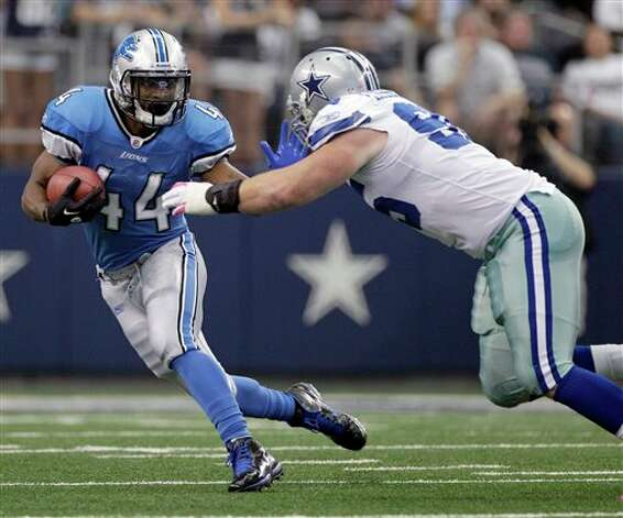 Detroit Lions running back Jahvid Best is tackled by Dallas Cowboys defensive tackle Sean Lissemore during the first half of an NFL football game Sunday, Oct. 2, 2011, in Arlington, Texas. (AP Photo/Tony Gutierrez) Photo: Tony Gutierrez, Associated Press / AP