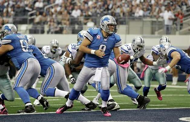 Detroit Lions' Matthew Stafford hands the ball off from the end zone during the first half against the Dallas Cowboys an NFL football game Sunday, Oct. 2, 2011, in Arlington, Texas. (AP Photo/Tony Gutierrez) Photo: Tony Gutierrez, Associated Press / AP
