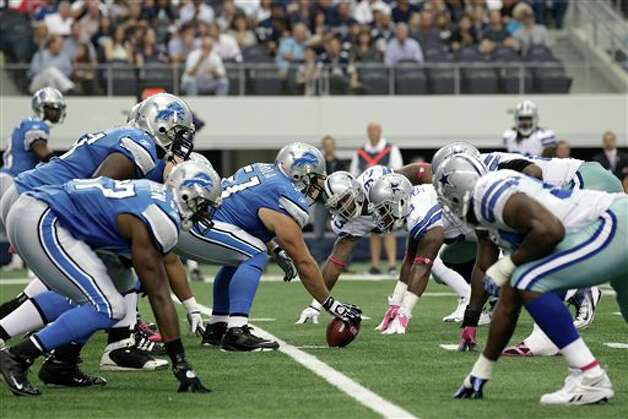 The Detroit Lions and Dallas Cowboys in the first half of  an NFL football game Sunday, Oct. 2, 2011, in Arlington, Texas. (AP Photo/Tony Gutierrez) Photo: Tony Gutierrez, Associated Press / AP