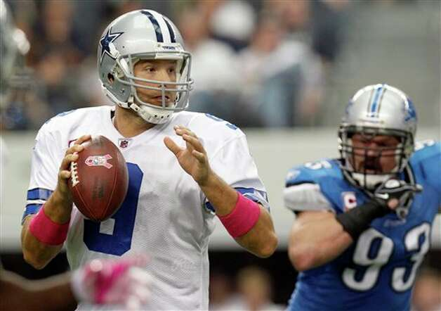Dallas Cowboys quarterback Tony Romo looks to pass as Detroit Lions defensive end Kyle Vanden Bosch moves in during the first half of an NFL football game Sunday, Oct. 2, 2011, in Arlington, Texas. (AP Photo/LM Otero) Photo: LM Otero, Associated Press / AP