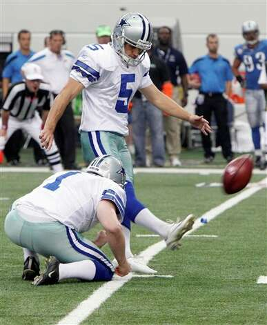 With Dallas Cowboys' Mat McBriar holding,  Dan Bailey makes a field goal  against the Detroit Lions during the first half of an NFL football game Sunday, Oct. 2, 2011, in Arlington, Texas. (AP Photo/LM Otero) Photo: LM Otero, Associated Press / AP