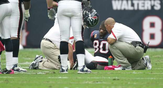 Houston Texans wide receiver Andre Johnson receives attention after being shaken up on a play against the Pittsburgh Steelers during the second quarter of a NFL football game at Reliant Stadium on Sunday, Oct. 2, 2011, in Houston. Photo: Nick De La Torre, Houston Chronicle / © 2011  Houston Chronicle