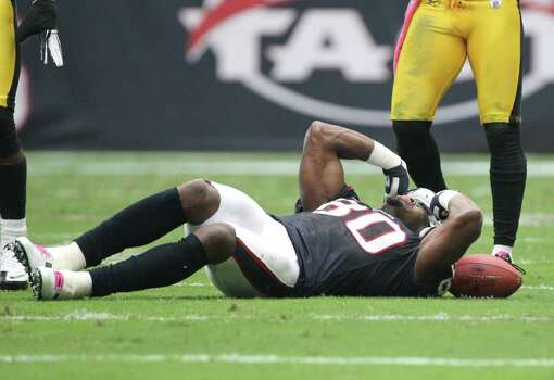 Houston Texans wide receiver Andre Johnson reacts after being shaken up on a play against the Pittsburgh Steelers during the second quarter of a NFL football game at Reliant Stadium on Sunday, Oct. 2, 2011, in Houston. Johnson left the game after the play. Photo: Nick De La Torre, Houston Chronicle / © 2011  Houston Chronicle