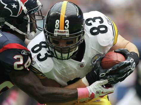 Houston Texans cornerback Johnathan Joseph (24) brings down Pittsburgh Steelers tight end Heath Miller (83) during the second quarter of a NFL football game at Reliant Stadium on Sunday, Oct. 2, 2011, in Houston. Photo: Nick De La Torre, Houston Chronicle / © 2011  Houston Chronicle
