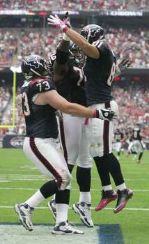 Houston Texans tight end Owen Daniels (81) celebrates with offensive tackle Duane Brown (76) and tackle Eric Winston (73) after scoring on a 1-yard touchdown catch during the first quarter of a NFL football game against the Pittsburgh Steelers at Reliant Stadium on Sunday, Oct. 2, 2011, in Houston. Photo: Nick De La Torre, Houston Chronicle / © 2011  Houston Chronicle
