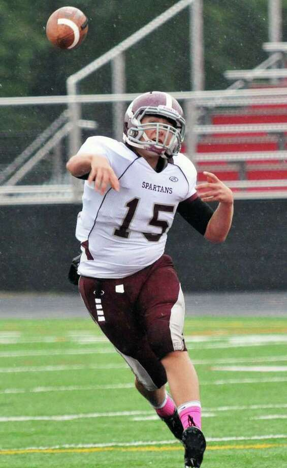 Burnt Hills' quarterback Ryan McDonnell fires off a pass during Saturday's game at Glens Falls High Oct. 1, 2011.  (John Carl D'Annibale / Times Union) Photo: John Carl D'Annibale / 00014787A