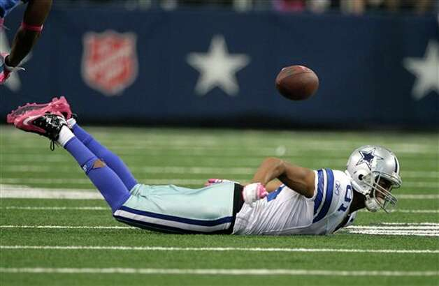 Dallas Cowboys wide receiver Laurent Robinson (81) is unable to bring in a pass during an NFL football game against the Detroit Lions Sunday, Oct. 2, 2011, in Arlington, Texas. The Lions won 34-30. Photo: Tony Gutierrez, AP / AP