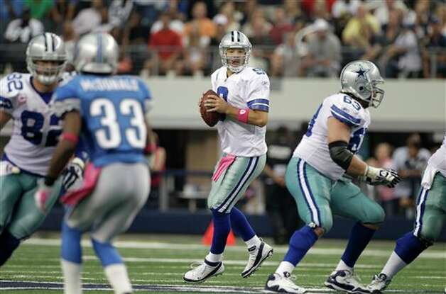 Dallas Cowboys quarterback Tony Romo (9) drops back in the pocket in an NFL football game against the Detroit Lions  Sunday, Oct. 2, 2011, in Arlington, Texas. The Lions won 34-30. Photo: Tony Gutierrez, AP / AP