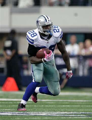 Dallas Cowboys running back Felix Jones (28) on a carry late in an NFL football game against the Detroit Lions Sunday, Oct. 2, 2011, in Arlington, Texas. The Lions won 34-30. Photo: Tony Gutierrez, AP / AP