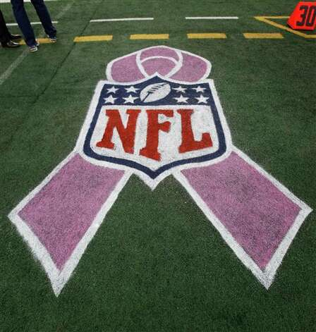 A breast cancer awareness ribbon on the field before an NFL football game Sunday, Oct. 2, 2011, in Arlington, Texas. Photo: LM Otero, AP / AP